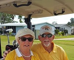 Dave &Pat Sitko sitting in Golf Cart